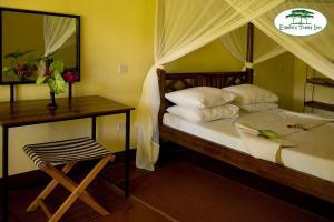 Posteľ alebo postele v izbe v ubytovaní Eileen's Trees Inn