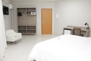A bed or beds in a room at Gran Park Hotel e Convenções