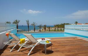 The swimming pool at or near King Evelthon Beach Hotel & Resort
