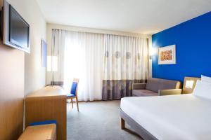 Cama o camas de una habitación en Novotel Lisboa