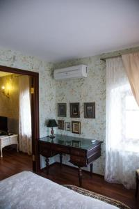 A bed or beds in a room at Boutique Apartments Pokrovka 9A