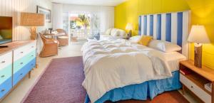 A bed or beds in a room at Bimini Big Game Club Resort & Marina