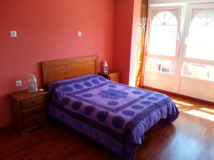 A bed or beds in a room at Albergue La Espiral