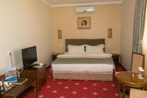 Un pat sau paturi într-o cameră la Elektra Vama Veche