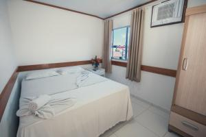 A bed or beds in a room at Hotel Morro da Saudade