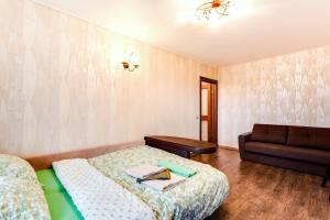 Кровать или кровати в номере FortEstate Volgina 25