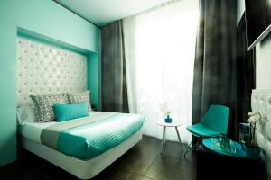 A bed or beds in a room at Hotel 54 Barceloneta