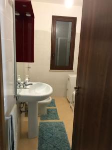 A bathroom at Casa Vacanza Villaggio Solaris