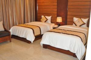Giường trong phòng chung tại Duy Anh Hotel