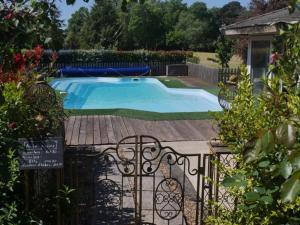 The swimming pool at or near Château de la Haye