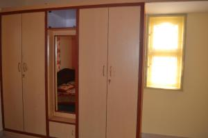 A television and/or entertainment centre at Manasvini Homestay-A home in Mysore with scenic view