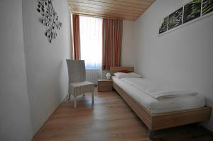 A bed or beds in a room at Apartements Wallner