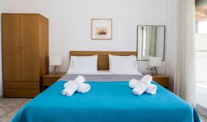 A bed or beds in a room at Pansion Argo