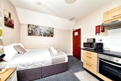 United Lodge Hotel and Apartments - Laterooms