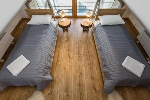 A bed or beds in a room at Smrekowa Polana Resort & Spa