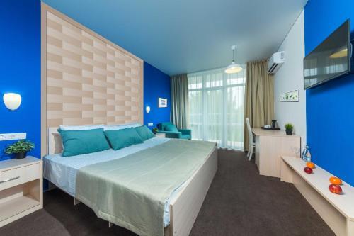 Кровать или кровати в номере MoreLeto Ultra All Inclusive in Miracleon
