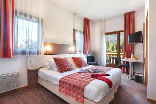 Un ou plusieurs lits dans un hébergement de l'établissement Vacancéole - Résidence Grand Massif