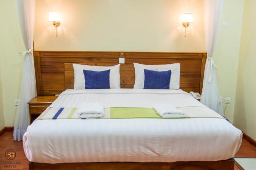 A bed or beds in a room at Eastmark Hotel