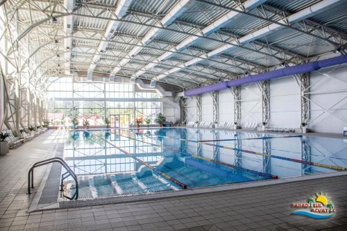 The swimming pool at or near Hotel Alinalex - Paradisul Acvatic