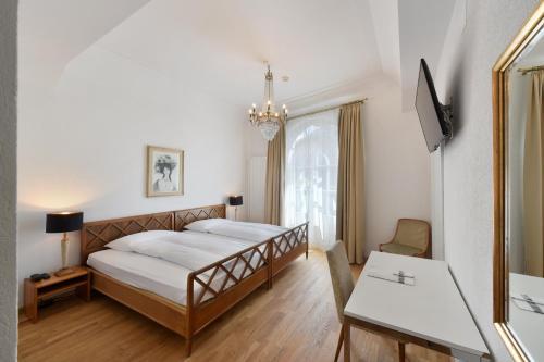 Ein Bett oder Betten in einem Zimmer der Unterkunft Hotel National Bern