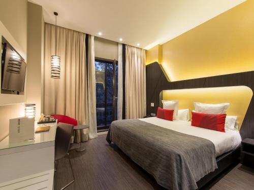 Ein Bett oder Betten in einem Zimmer der Unterkunft Vincci Gala