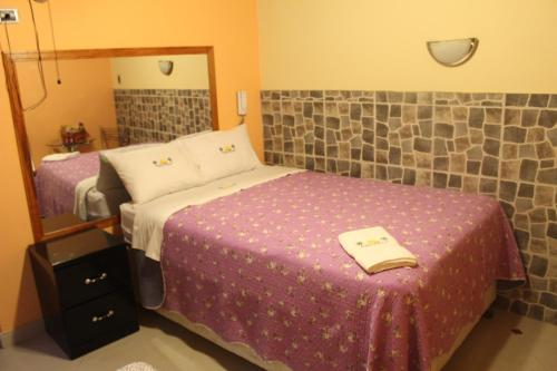 A bed or beds in a room at Paradisse