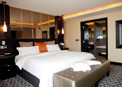 A bed or beds in a room at The Vincent Hotel
