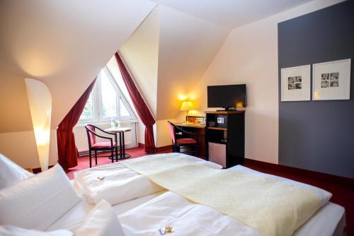 Ein Bett oder Betten in einem Zimmer der Unterkunft City Hotel Aschersleben