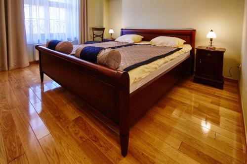 Łóżko lub łóżka w pokoju w obiekcie Centrum Obsługi Turysty Kordegarda