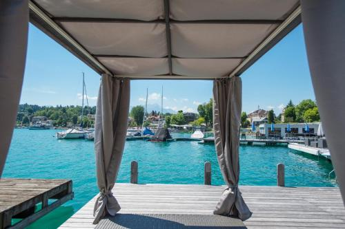 The swimming pool at or near Boutiquehotel Wörthersee