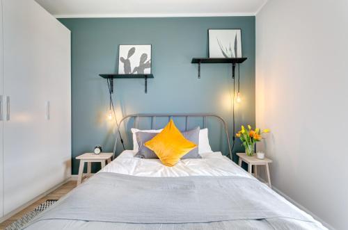Łóżko lub łóżka w pokoju w obiekcie Emarald Apartment