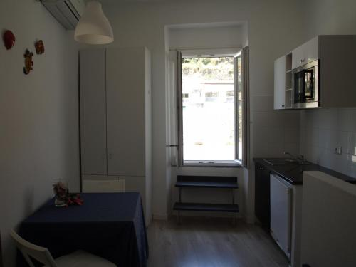 A kitchen or kitchenette at Acla Apartments