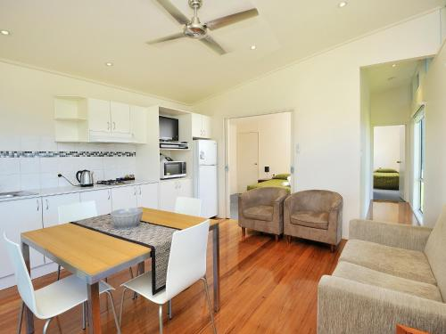 A kitchen or kitchenette at NRMA Eastern Beach Holiday Park