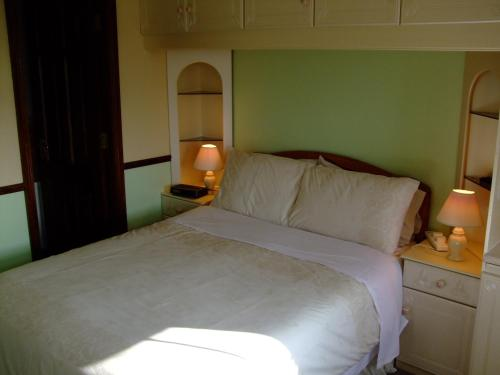 A bed or beds in a room at Church View B&B