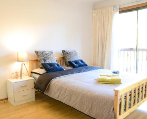 A bed or beds in a room at House in Epping