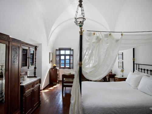 A bed or beds in a room at 1864 The Sea Captain's House