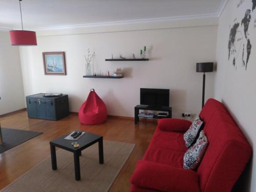 A seating area at Zé da Rita Apartment