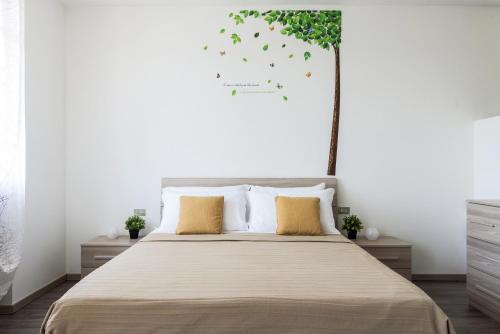 Letto o letti in una camera di Cernobbio Lake View - byMyHomeinComo