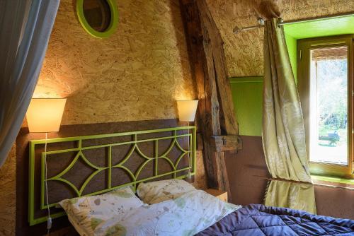 Un ou plusieurs lits dans un hébergement de l'établissement Le Moulin Berthon