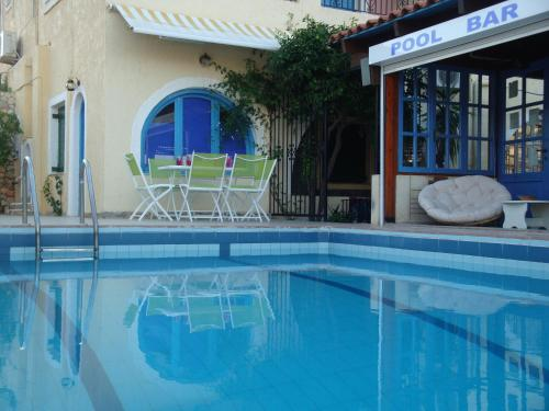 The swimming pool at or near Maria-Flora Apartments