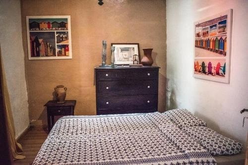 A bed or beds in a room at Casa Antonia Guest House