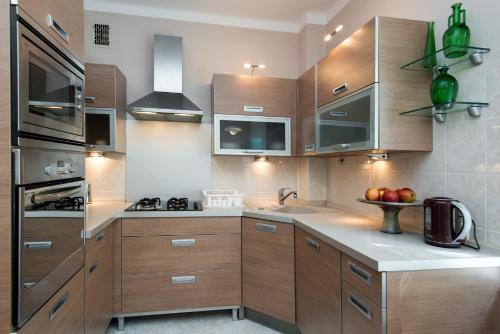 Kuchnia lub aneks kuchenny w obiekcie Apartament w Śródmieściu