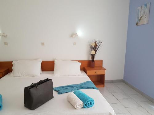 A bed or beds in a room at Pyrgos Hotel Apartments