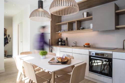 A kitchen or kitchenette at Le Génépy - Appart'hôtel de Charme