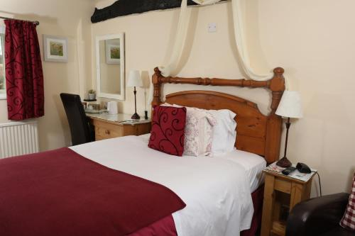 A bed or beds in a room at The Barns Country Guesthouse