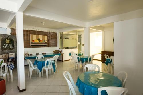 A restaurant or other place to eat at Pousada Vila dos Ventos