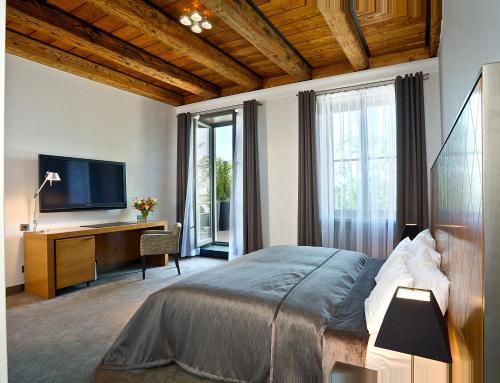 Кровать или кровати в номере Hotel Albrecht