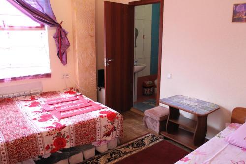 Кровать или кровати в номере Гостевой Дом «Делиф»