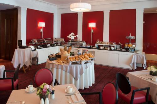 A restaurant or other place to eat at Beau Rivage Hotel