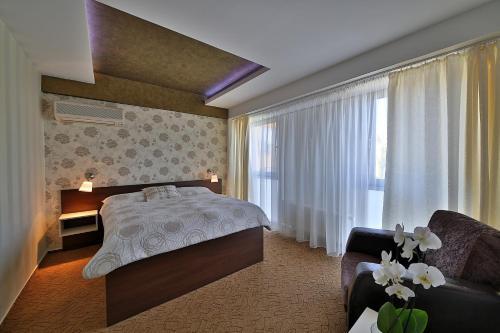 Кровать или кровати в номере Hotel Šariš